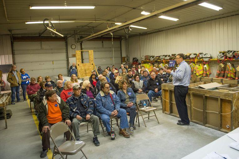Een typische caucus in Iowa: gewone Amerikanen komen bij elkaar om te discussiëren over de kandidaat van hun voorkeur.