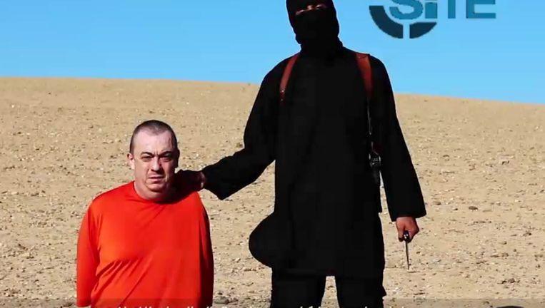 Een beeld uit de video waarop gedreigd wordt Alan Henning te doden Beeld AFP