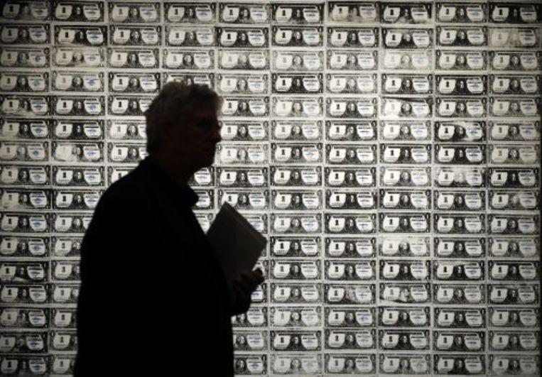 Het kunstwerk '200 One Dollar Bills' van Andy Warhol leverde omgerekend 29 miljoen euro op (archieffoto 30-10-2009). ANP Beeld