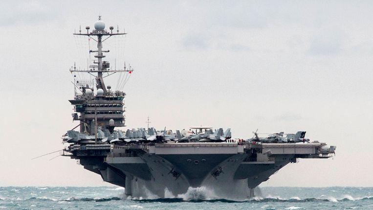 De USS Harry S. Truman, vermoedelijk het Amerikaanse vliegdekschip waarvan Iran foto's nam. Het schip bevindt zich op dit ogenblik in de Perzische Golf. Beeld AP