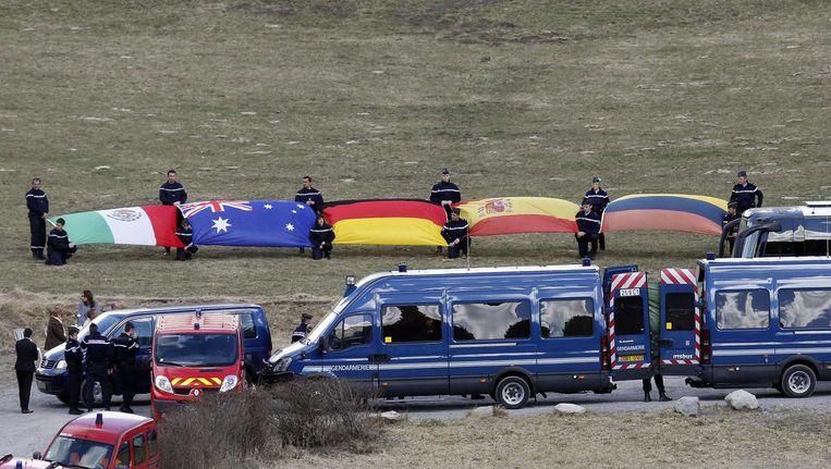 De vlaggen van landen van waar de slachtoffers van de vliegramp met de Germanwings vandaan komen. Beeld null