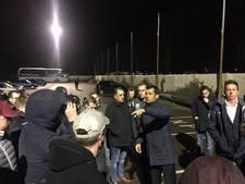 Supporters Helmond Sport  wachten spelersbus op na zeperd bij Jong PSV