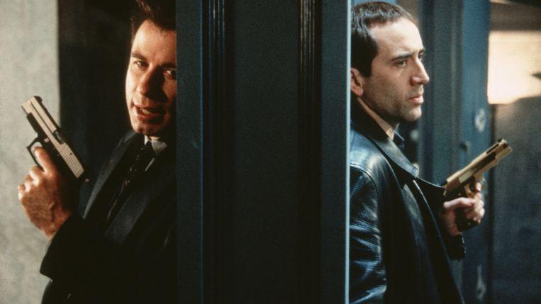 John Travolta (links) en Nicolas Cage in Face/Off. Beeld