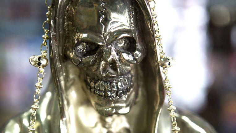 Beeld van Santa Muerte, de heilige van de dood. Beeld Julius Schrank