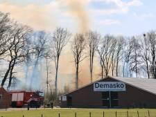 Grote brand in Tilligte: berg snoeiafval vat vlam
