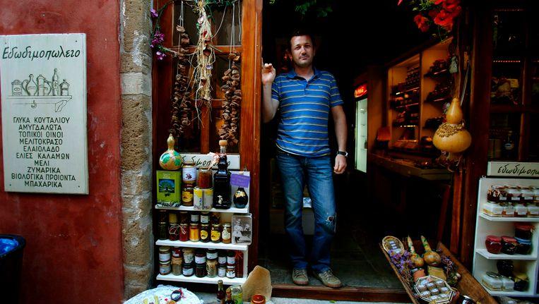 Ook de Griek Paraskevas Christoforakis verkoopt olijfolie Beeld Reuters