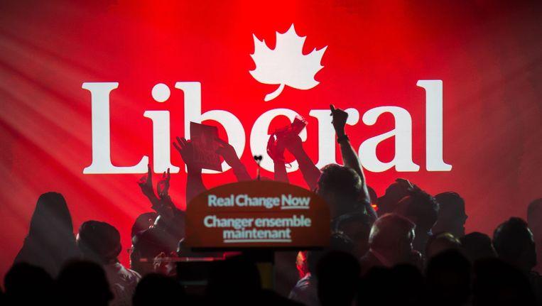 Aanhangers van de liberale partij juichen bij de eerste voorlopige uitslagen Beeld afp