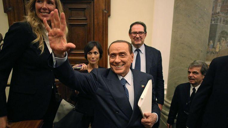 Berlusconi en een aantal leden van de PDL. Beeld EPA