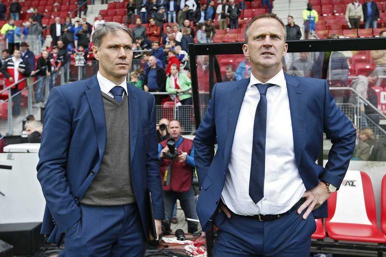 Marco van Basten met AZ-hoofdtrainer John van den Brom. Beeld anp