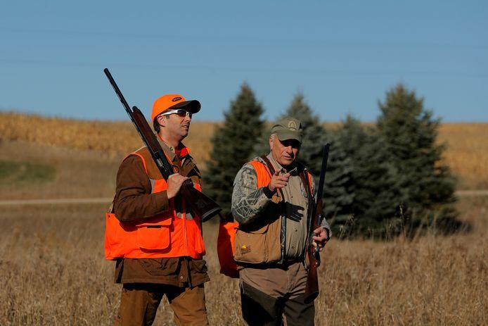 Donald Trump (l.) bij een fazantenjacht in Iowa.