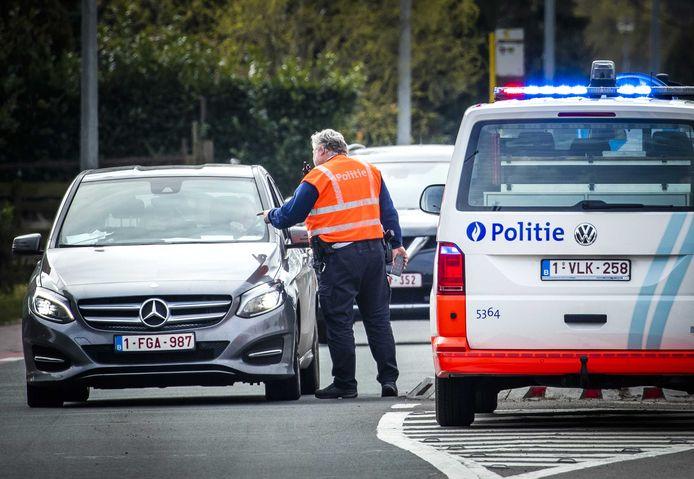 De grenscontrole op weg en van Baarle-Hertog.