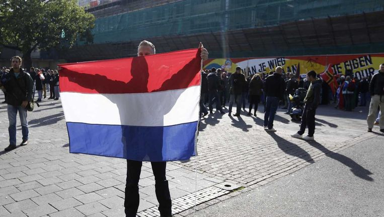 Een van de betogers op het Vredenburg in Utrecht. Beeld ANP