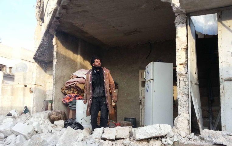 Verwoeste huizen in Azaz. Beeld getty