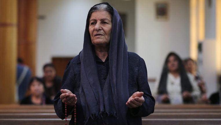 Een gevluchte christen in Erbil, Irak, afgelopen zomer. Beeld epa