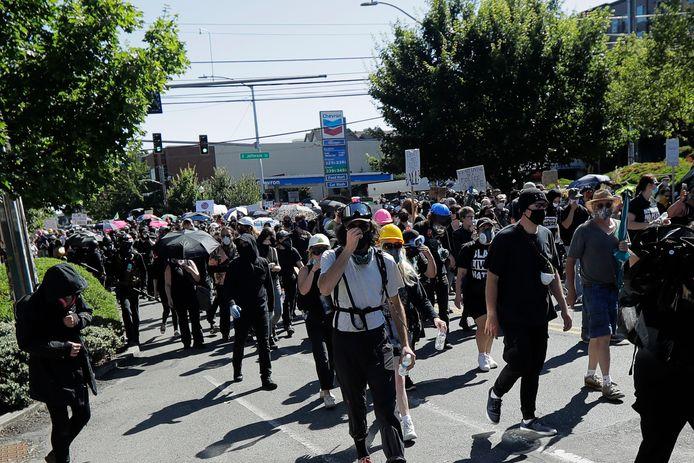 Demonstranten marcheren door Seattle.