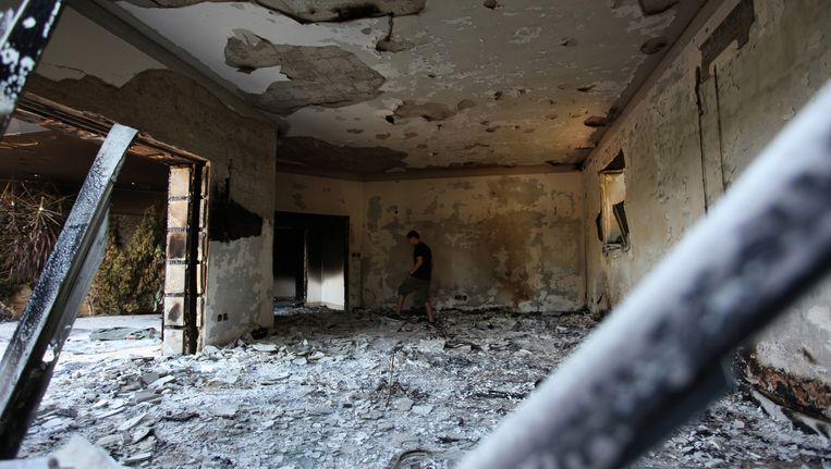 De resten van het Amerikaanse consulaat in Libië na de aanslag in 2012. Beeld ap