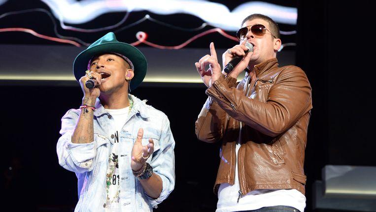 Pharrell Williams (links) en Robin Thicke. Beeld getty
