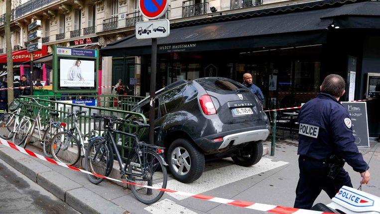 De auto van de onfortuinlijke chauffeur. Beeld Reuters