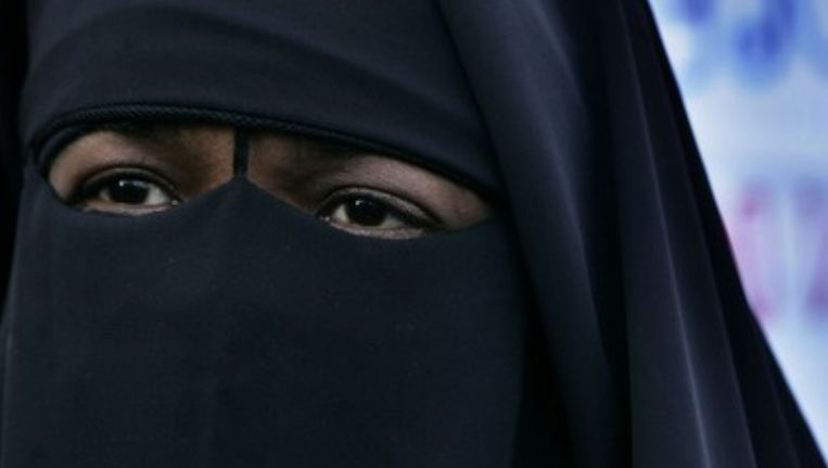 Gezichtsbedekkende kleding zoals de niqaab mogen straks niet meer in de openbare ruimte worden gedragen. ©ANP Beeld