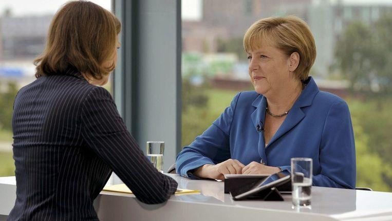 Bondskanselier Angela Merkel zondag in de uitzending van de ZDF. Beeld epa