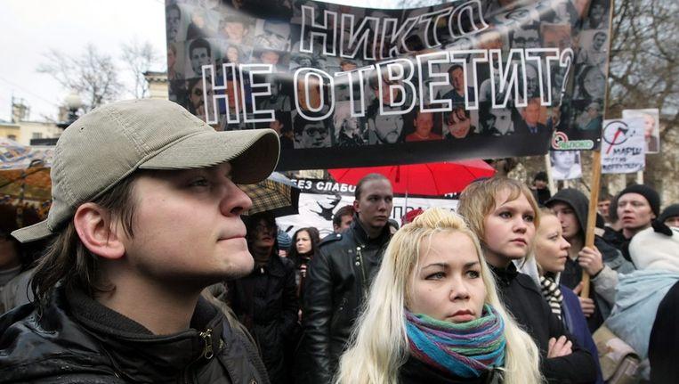 Russische demonstranten eisen de opsporing en berechting van de twee mannen die Kasjin in elkaar sloegen. Beeld epa