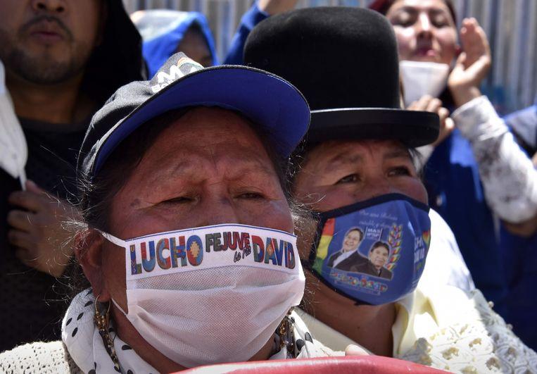 Aanhangers van de linkse presidentskandidaat Luis Arce, die maandag de verkiezingen in Bolvia won.  Beeld AFP