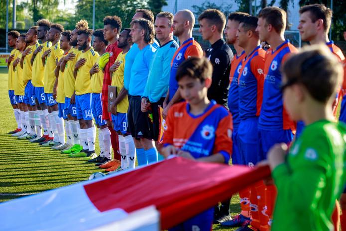 Goirle, 24 mei 2019Salomonseilanden vlak voor de wedstrijd tegen VOAB. Het is onderdeel van een officiële openingsceremonie voordat de interland start. Salomon in het geel zingt mee met het volkslied bij de interland.