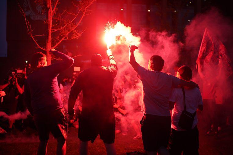 Liverpool-fans vieren donderdagavond het landskampioenschap. Beeld Getty Images