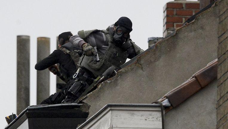 Scherpschutters van de Belgische politie in Molenbeek. Beeld BELGA