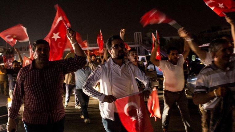 Turken op straat in Ankara. Beeld anp