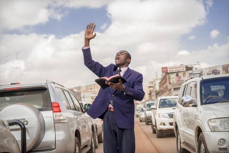 Straatpredikant Said Aminadabu. Beeld Sven Torfinn / de Volkskrant