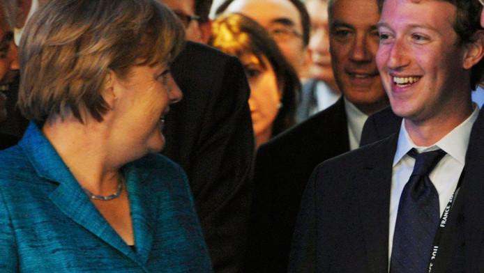 Angela Merkel en Mark Zuckerberg (archieffoto)