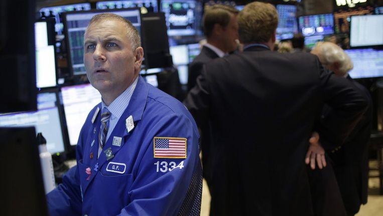 Een handelaar op de beursvloer van de New York Stock Exchange. Beeld ap