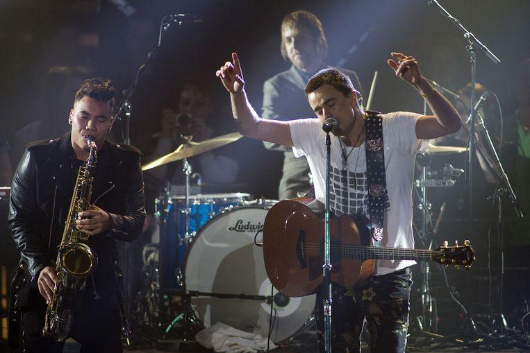 Zanger Dinand Woesthoff (R) van de band Kane treedt op tijdens de uitreiking van de 3FM Awards in de Gashouder op het Westergasterrein. Beeld anp