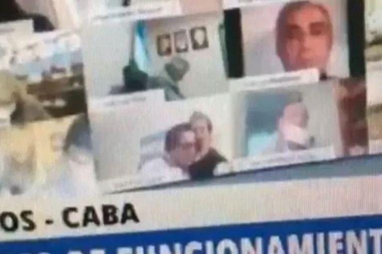 Juan Emilio Ameri raakte in opspraak nadat hij de borsten van zijn vrouw kuste tijdens een videovergadering. Beeld Screenshot