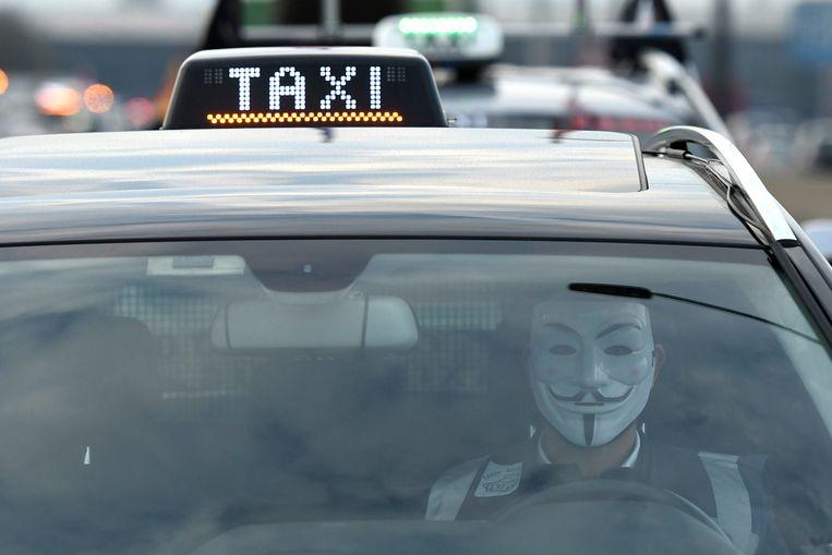 Taxichauffeurs protesteerden in maart vorig jaar nog tegen Uber.