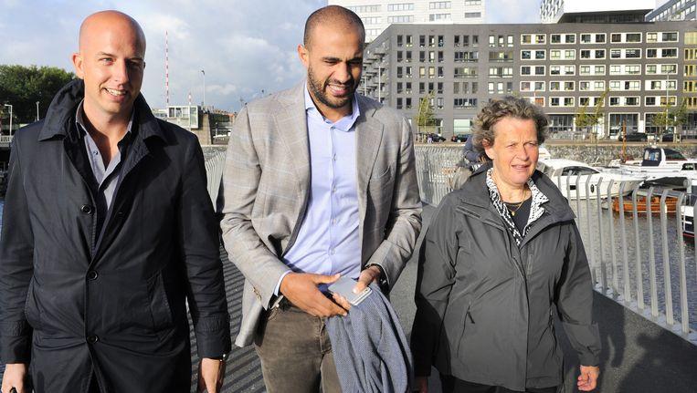 Badr Hari met advocaten Christian Flokstra en Benedicte Ficq. Beeld anp