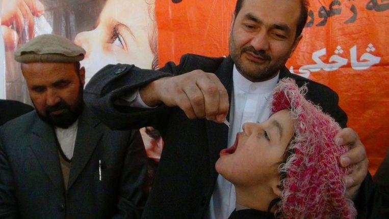 In Afghanistan is ook een vaccinatie campagne tegen polio begonnen. Beeld afp