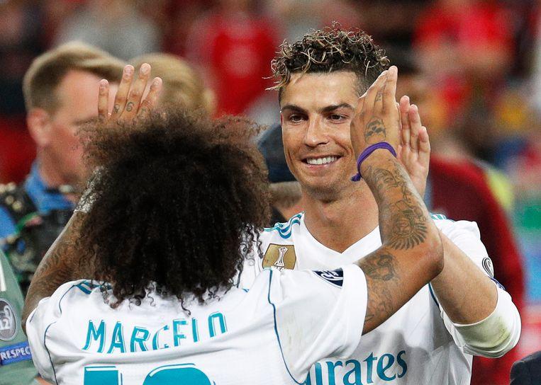 Marcelo met Cristiano Ronaldo nadat ze de Champions League wonnen.