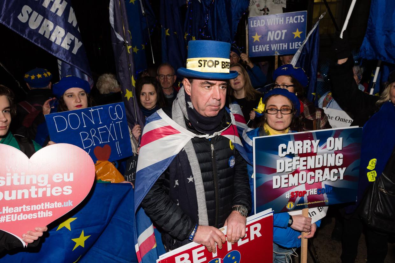 Demonstranten tegen een vertrek uit de Europese Unie bij de ambtswoning van premier Boris Johnson, begin januari.  Beeld Barcroft Media via Getty Images