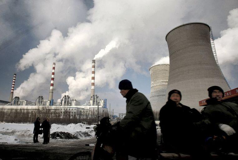 Een steenkoolcentrale in Changchun, China. De Verenigde Staten, India en China zijn de grootste producenten van broeikasgassen ter wereld. Beeld ap