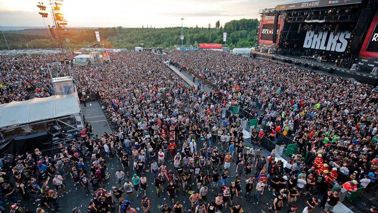 Bezoekers verlaten het festival. Beeld EPA