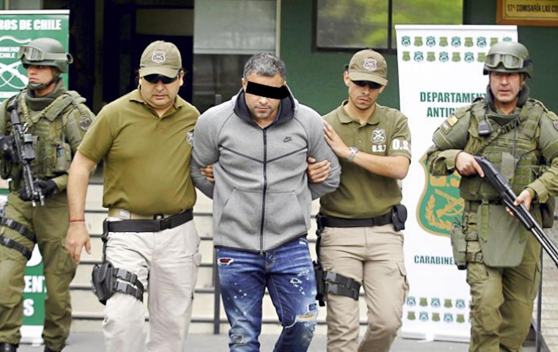 'Rico de Chileen' wordt in oktober 2017 in Chili opgepakt in de garage van een hotel waar hij verbleef met zijn Colombiaanse vriendin Beeld