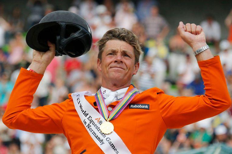 Jeroen Dubbeldam werd zondag de allereerste wereldkampioen ooit voor Nederland op het onderdeel springen. Beeld reuters