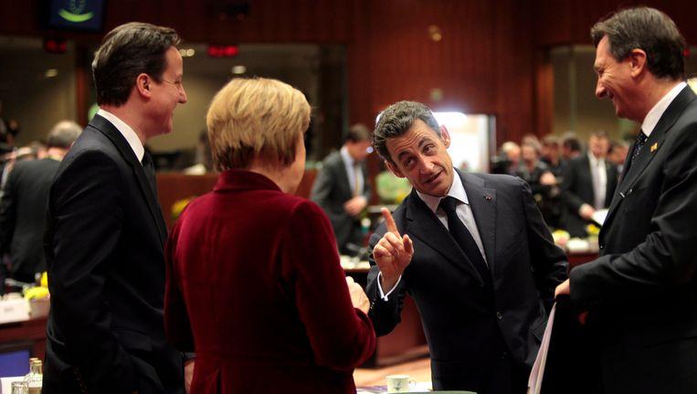 David Cameron, Angela Merkel en Nicolas Sarkozy in Brussel, gisteravond. Beeld epa