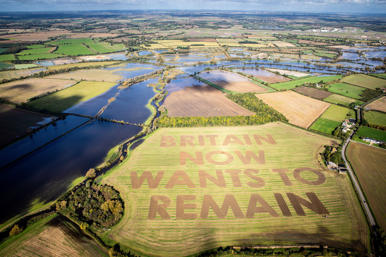 """The words """"Britain now wants to remain"""" cut by anti-Brexit group Led By Donkeys are seen in a field near Swindon, county Wiltshire, Britain October 16, 2019. Picture taken October 16, 2019. Led By Donkeys/via REUTERS THIS IMAGE HAS BEEN SUPPLIED BY A THIRD PARTY. MANDATORY CREDIT"""