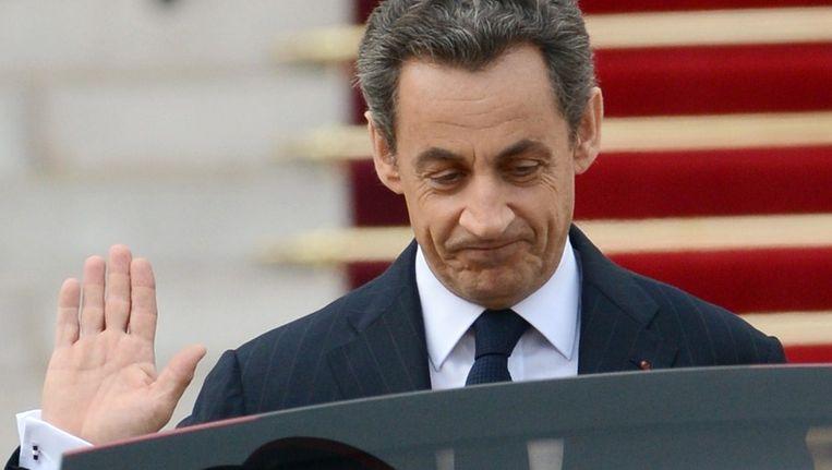 Sarkozy tijdens zijn vertrek als president uit het Elysée. Beeld afp