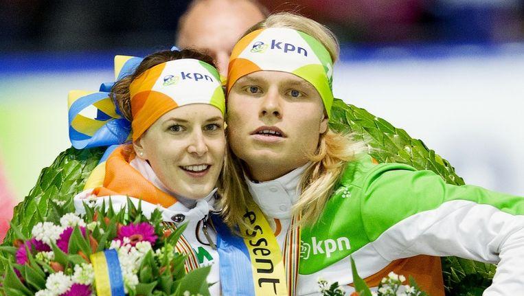 - Ireen Wust en Koen Verweij op het podium tijdens het wereldkampioenschap allround in het Thialf stadion Beeld ANP