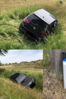 Verlaten auto met flinke bus lachgas gevonden in de sloot bij Oirschot