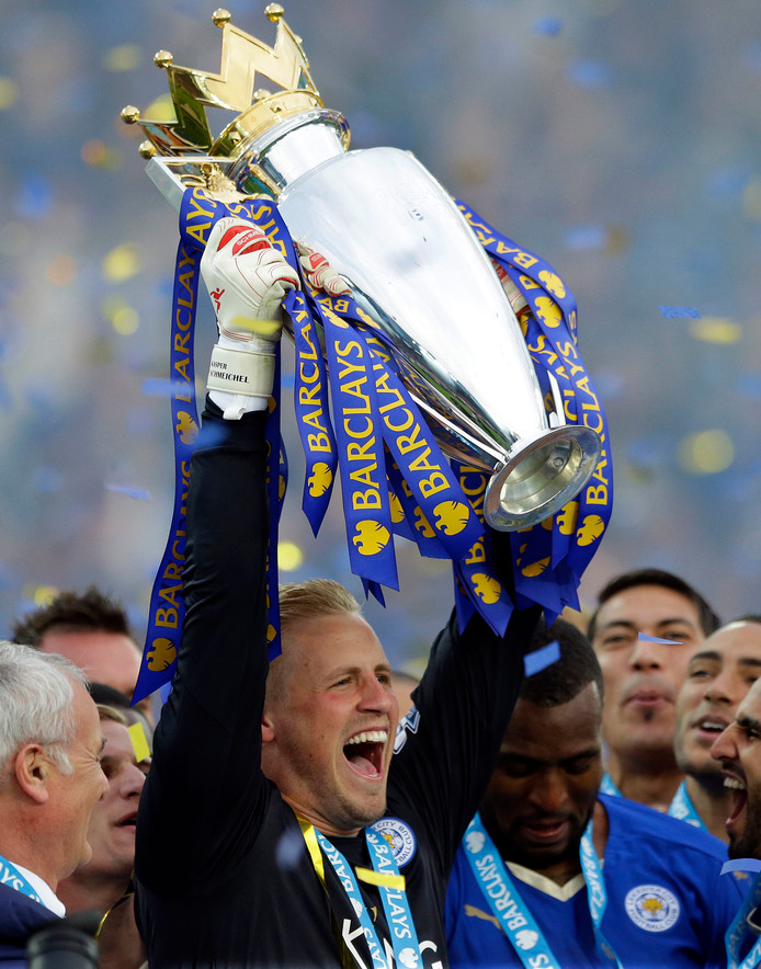 FILE - In this May 7, 2016, file photo, Leicester's goalkeeper Kasper Schmeichel lifts the trophy as Leicester City celebrate becoming the English Premier League soccer champions at King Power stadium in Leicester, England. The Schmeichel's are one of many father-son duos in sports around the world spending time together on a daily basis. (AP Photo/Matt Dunham, File)